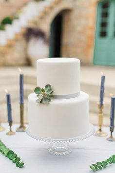all white wedding cake with succulent