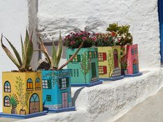 Borderline cute and handmade pots using old metal oil containers. OMG how awesome greek islands are?