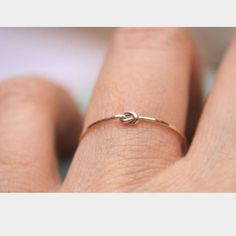 Delicate Gold Knot Ring Thin delicate beautiful new ring - gold tone - size 7 Jewelry Rings