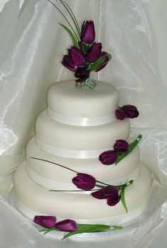 Google Image Result for http://cherrymarry.com/wp-content/uploads/2012/03/white-wedding-cakes-with-purple-tulips.jpg