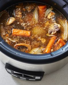 How To Make Beef Bone Broth on the Stove or in a Slow Cooker — Cooking Lessons from The Kitchn Bone Broth Crockpot, Slow Cooker Bone Broth, Chicken Bone Broth Recipe, Bone Broth Soup, Making Bone Broth, Homemade Bone Broth, Slow Cooker Beef, Slow Cooker Recipes, Beef Recipes