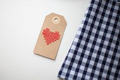 Embroidered paper tags