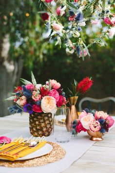 """Because who just thinks, """"yeah I'm just gonna put these flowers in this pineapple""""   a palm springs floral tablesacpe"""