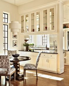 Kitchen - beautiful pass through cabinets with glass doors | Design Lines Ltd