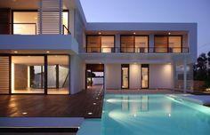 pool + wooden walkway + house