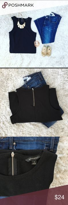 Banana Republic black Tank Perfect basic for anyone's closet. 100% cotton black tank top with zipper in back. Pair this with jeans and heels for date night or a skirt for work. Banana Republic Tops Tank Tops
