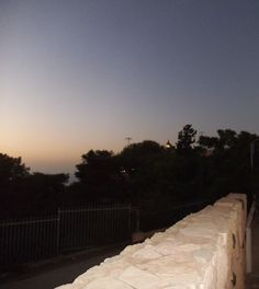 As the sun sank into the Meditenean sea the Lighthouse at the Edge of Mount Carmel lit up  photo mirjam Bruck -cohen