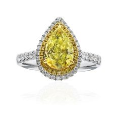 This ring is on FIRE - 2.10 carat pear shaped fancy light yellow diamond engagement ring