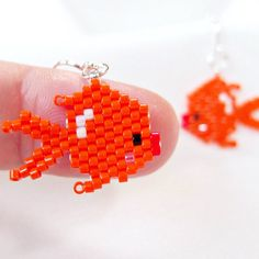 Cute beaded Goldfish Earrings on sterling silver ear wires. These adorable fishes are hand stitched with Delica seed beads in vibrant opaque orange