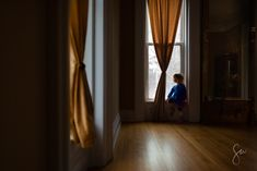 Little-Girl-Looking-Out-Window-in-Fancy-Room-with-Yellow-and-Blue-Color-Contrast-.jpg (1960×1308)