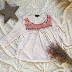 Cream 3/4 sleeve Tee Pre-loved. But only worn once. In excellent condition. Does fit shorter is thin and light weight perfect for summer.With a cute detail on the front chest area. Open to offers. Any questions please let me know.⭐️ Unknown Tops Tees - Long Sleeve