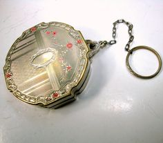 Coolest 1950s Compact on Finger Ring Chain, Face Powder Holder, Vintage Collectible Purse Trinket This could be Flapper era and NOT 1950s Im not sure. I like that it can slip on the finger and be held in the hand and still DANCE  Top inside lid has a Mirror  The Compact Powder purse snaps very tightly closed. This has been used. but cleaned of powder residue  Th compact is 2 1/4 wide by almost 1/2 thick ( 5.715cm x 1.2cm ) You could put coins in it if you pull the middle layer out ( easy)…