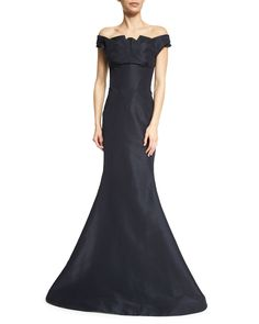 Zac Posen woven gown. Pleated off-the-shoulder neckline. Banded sleeves. Mermaid silhouette. Hem falls to floor. Train at back. Hidden back zip. Silk; dry clean. Made in USA of imported material.