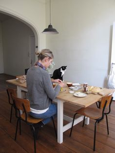 Cats will always sit on the table ;) you probably can't do anything about it .. Life :D