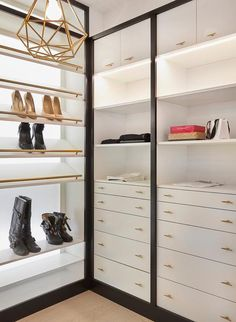 Izen Architecture – Contemporary black and white closet is fitted with white built in dressers accented with brass pulls and fixed beneath custom lit shelves located under white cabinets framed in black. White Closet, Walk In Closet, Closet Redo, Closet Ideas, Closet Island, Built In Dresser, Closet Colors, Closet Shelves, Closet Bedroom