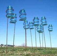 mason jar stakes  I have got to get me some mason jars.