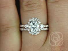 This wedding set is designed for those who love simple with a slight twist. With the combination of both the 3 stone and halo together, the ring is truly unique! All stones used are only premium cut, fairly traded, and/or conflict-free! Our diamonds are always natural NEVER treated or