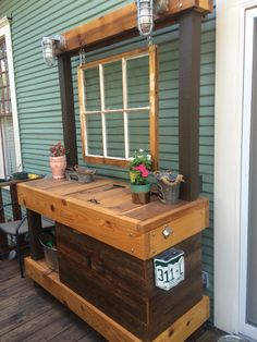 Custom built patio buffet with built in cooler, lights, and bottle opener