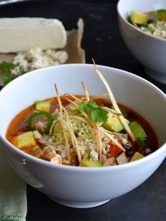 This is the most delicious Tortilla Soup recipe! Spicy, with complex flavors and topped with avocado, cotija cheese and thin crisp tortilla strips. Vegetarian Tortilla Soup, Tortilla Recipe, Vegan Soups, Vegetarian Recipes, Healthy Recipes, Vegan Tortilla, Paella, Avocado, Soup And Salad