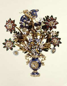 Gold jewelled and enamelled aigrette, 1710-1730. An aigrette or breast ornament, in gold, in the form of a bouquet of flowers, enamelled in naturalistic colours, in a two-handled vase set with diamonds. Possible date: c. 1720