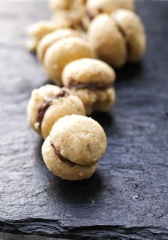 These cookies are about the cutest thing we've ever seen and they taste amazing! Light and airy, chocolate-filled and just one bite...you're going to want to make a few batches of these!