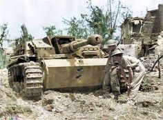 BRITISH ARMY ITALY 1944 (NA Troops examine a knocked-out German StuG III assault gun near Cassino, 18 May Two AP rounds from a Sherman tank have neatly penetrated its front armour. Panzer Iii, Tank Armor, Ww2 Photos, Ww2 Pictures, Tank Destroyer, British Soldier, British Army, Armored Fighting Vehicle, Ww2 Tanks