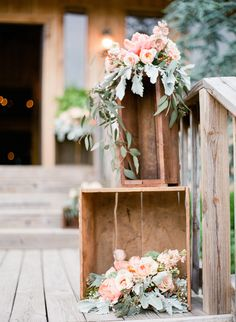 Nashville, TN wedding. Wooden box floral arrangement wedding reception. Wooden crate wedding reception flowers. Peonies. Green Door Gourmet Nashville wedding venue. Photo: Leslee Mitchell.