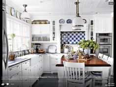 Love a blue and white kitchen and Love the table in the kitchen
