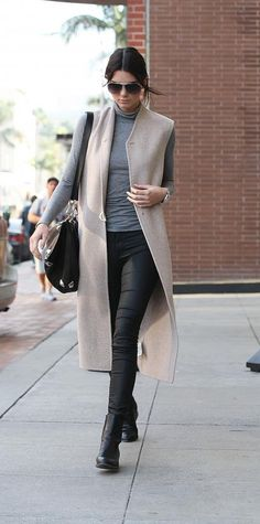 Winter outfit: beige long vest, grey turtleneck, slim leather pants, black booties, black bag