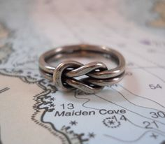 Square Knot Ring in Silver - i would love to get my hands on one of these! love the double band!