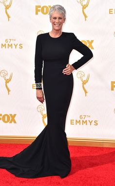 Emmys 15: Jamie Lee Curtis exudes class and elegance in a black long sleeve Stella McCartney gown with a high neckline. Simple but classy gown. The bracelet adds sparkle and shine.