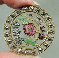 ANTIQUE BRASS FILIGREE BUTTON W/ ENAMEL FLORAL DESIGN & CUT STEELS