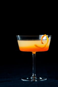bitter bitch | 2 oz (30 ml) limoncello 2 oz (30 ml) gin 1 oz (60 ml) tangerine juice 1 oz (30 ml) lemon juice 2 dashes of orange bitters 1/2 oz (15 ml) Aperol tangerine peel for garnish (optional)