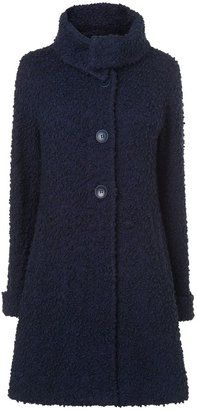 Stay snug in this knitted coat #coat #winter #fashion