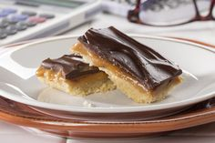 This cookie bar recipe will make you feel like a billion bucks! Our Billionaire Bars feature a layer of crumbly and buttery shortbread cookies, ooey-gooey caramel, and sweet-as-can-be chocolate ganache. It's dessert perfection!