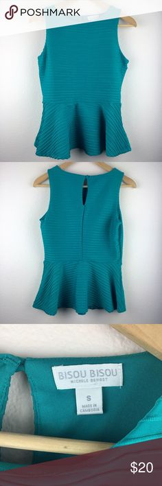 """Bisou Bisou Sleeveless Textured Peplum Top Brand: Bisou Bisou Michele Bohbot. Style: Sleeveless Textured Peplum Top. Material: Shell 92% Polyester 8% Spandex. Lining 100% Polyester. Color: Teal. Size Small. Length 23"""" Armpit to armpit 15 1/2"""". Back keyhole with button closure. Made in Cambodia. Can be worn from day to night. Bisou Bisou Tops Tank Tops"""