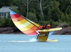 """Hobie sailing. Looks like the way I used to sail my boat. Mine actually had to have a """"This side up"""" sign on it ;)"""