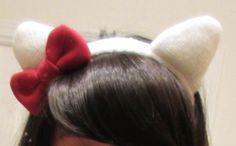 Hello Kitty Ears Headband. I know someone who's a big fan of hello kitty.