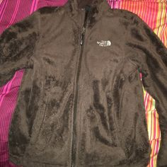 Brown fuzzy north face jacket Had this jacket for awhile, never wear it anymore. Still has some good years of wear in it! It is a size small, brown fuzzy north face. North Face Jackets & Coats
