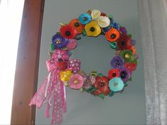 Wicker wreath with handmade flowers from polymer clay