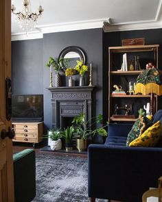 Painting a room black doesn& mean that it will automatically feel gothic. Painting a room black doesn& mean that it will automatically feel gothic. These easy tips and tricks will help you pull off this daring color. Feature Wall Living Room, Dark Living Rooms, Living Room Grey, Home Living Room, Living Room Designs, Gothic Living Rooms, Black Living Room Furniture, Furniture Decor, Furniture Outlet