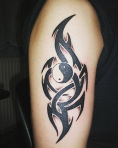 Yin Yang tattoo symbol armed with tribal symbols. This is a wonderful way to make the simple Yin Yang tattoo stand out by adding intricate and amazing tribal patterns.