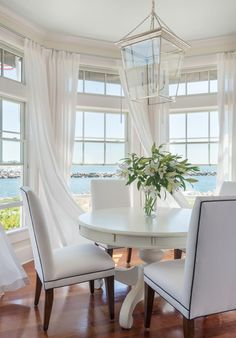 Beach house chic with #sunbrella sheers and upholstered chair fabrics