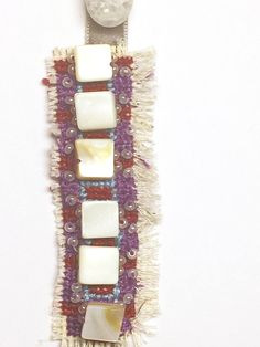 Earthy embroidered bookmark with velvet tail