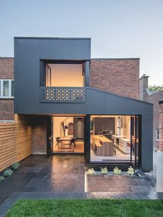"""This is the """"Black Box II,"""" a project by Natalie Dionne Architecture, located in Quebec, Canada. The art of architecture manifests itself here in all its dimensions. We love this semi-detached townhouse, made of red clay brick - what do you think? Semi Detached, Detached House, House Extension Design, House Design, Residential Architecture, Modern Architecture, Architecture Layout, Amazing Architecture, Renovation Facade"""