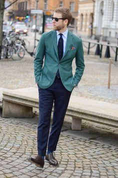 Green cotton sport coat, navy pants, blue shirt, navy tie, brown shoes, sunglasses, pocket square
