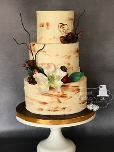 Woodland themed wedding cake. Buttercream iced cake with handmade sugar flower, pine cones, berries and pecans.