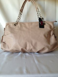 Cream Purse.   Available at www.rmfashions.net