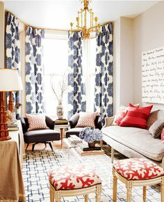 Love the large print drape in the bay window mixed with the geometric blue/white white area carpet- it allows the beautiful red and white ' coral pattern' to pop!