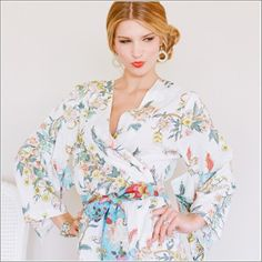 Eden inspired flora that beckon for a closer look rest upon this dreamy kimono sleeve-style crossover robe with self-tie sash and inner tie. On whisper-soft indian cotton voile, this beauty is perfect for the sweet unwind. Kimono Style Robe. Ankle Length. Beckoning Creatures.